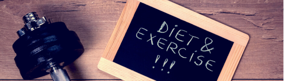 Reminder to diet and exercise on small chalkboard with dumbbell